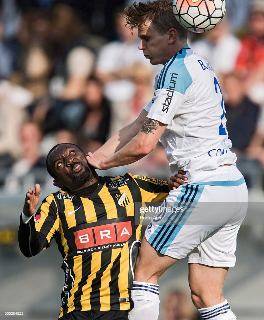 John Owoeri of BK Hacken and Tim Bjorkstrom of Djurgardens IF battles for the ball during the Allsvenskan match between BK Hacken and Djurgardens IF at Bravida Arena on May 29, 2016 in Gothenburg, Sweden.