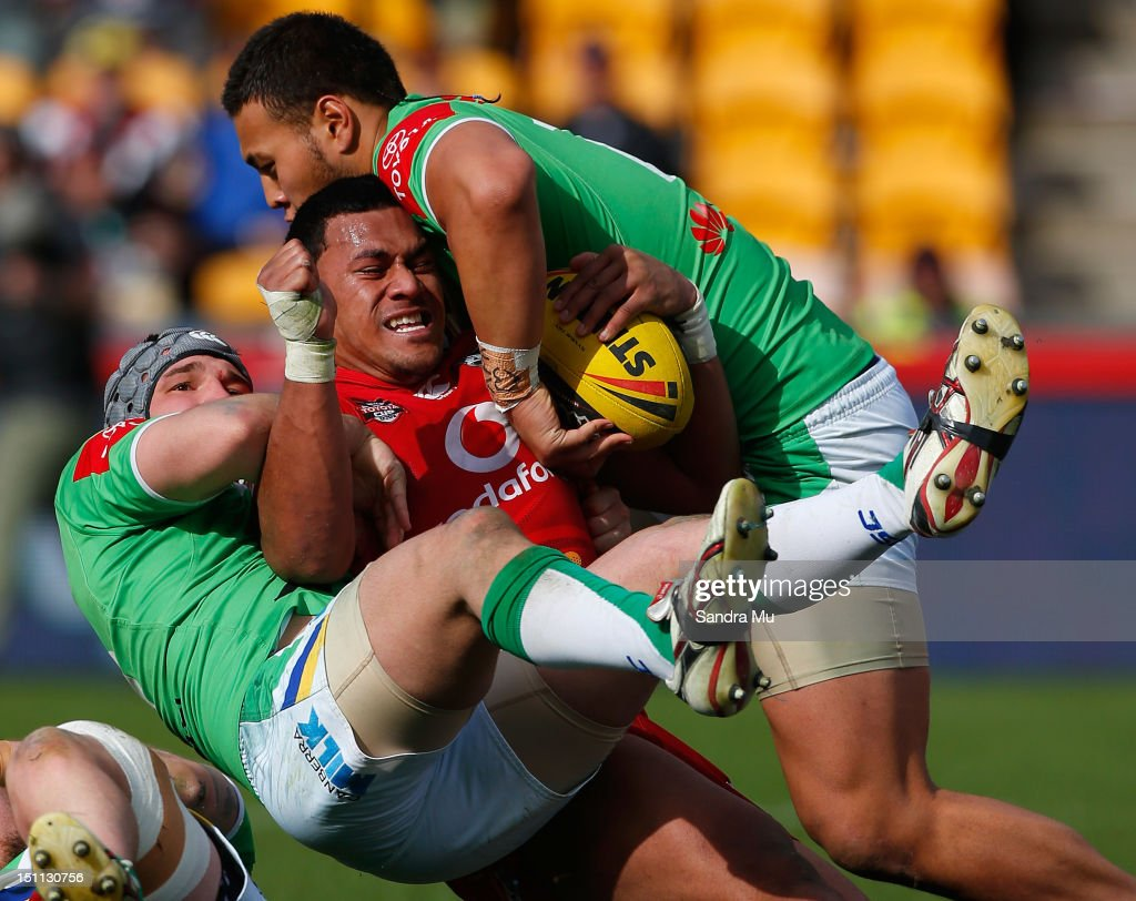John Palavi of the Junior Warriors is tackled during the Toyota Cup round 26 match between the New Zealand Warriors and the Canberra Raiders at Mt Smart Stadium on September 2, 2012 in Auckland, New Zealand.