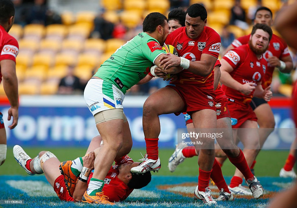 John Palavi of the Junior Warriors (R) tackles Uiti Baker of the Junior Raiders during the Toyota Cup round 26 match between the New Zealand Warriors and the Canberra Raiders at Mt Smart Stadium on September 2, 2012 in Auckland, New Zealand.