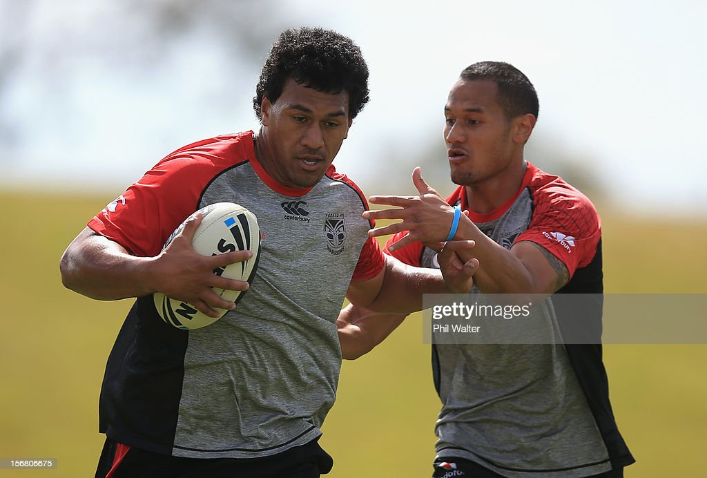 John Palavi of the Warriors fends during a New Zealand Warriors NRL pre-season training session at the Millenium Institute on November 22, 2012 in Auckland, New Zealand.