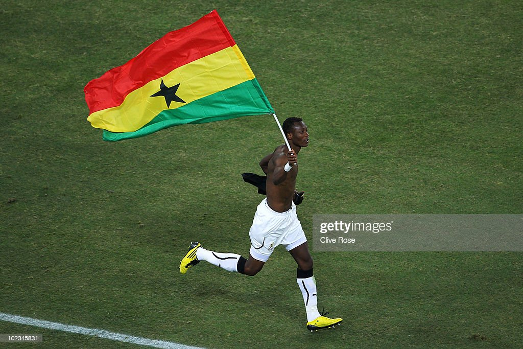 John Pantsil of Ghana celebrates with a national flag having qualified for the next round, despite losing the match, during the 2010 FIFA World Cup South Africa Group D match between Ghana and Germany at Soccer City Stadium on June 23, 2010 in Johannesburg, South Africa.