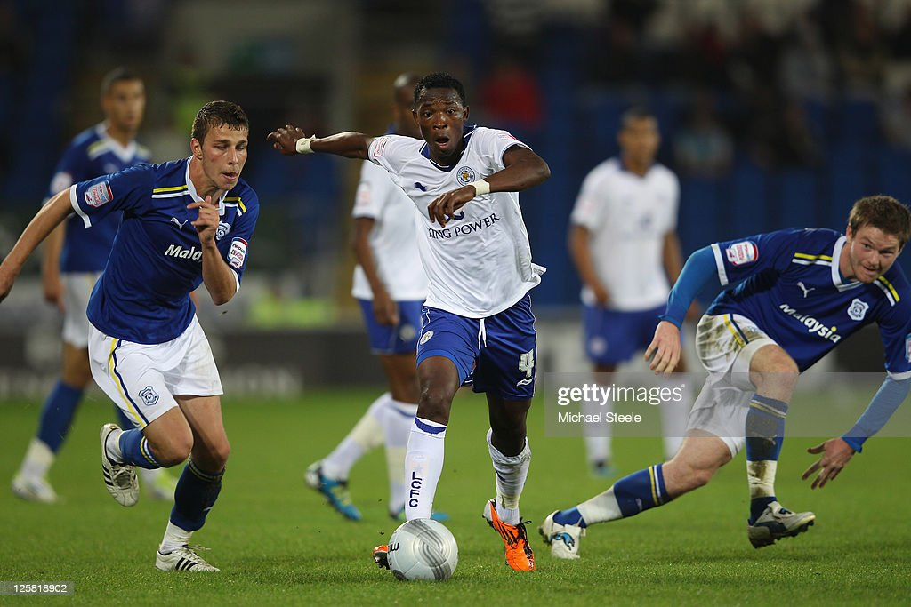 John Pantsil (C) of Leicester City cuts between Filip Kiss (L) and Darcy Blake (R) of Cardiff City during the Carling Cup third round match between Cardiff City and Leicester City at the Cardiff City Stadium on September 21, 2011 in Cardiff, Wales.