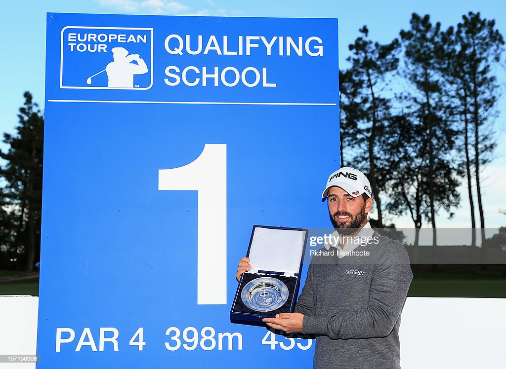 John Parry of England poses with the trophy after the final round of the European Tour Qualifying School Finals at PGA Catalunya Resort on November 29, 2012 in Girona, Spain.