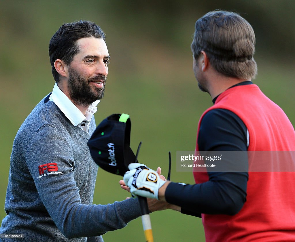 John Parry of England (L) shakes hands with Mikko Korhonen of Finland as Parry secures victory during the final round of the European Tour Qualifying School Finals at PGA Catalunya Resort on November 29, 2012 in Girona, Spain.