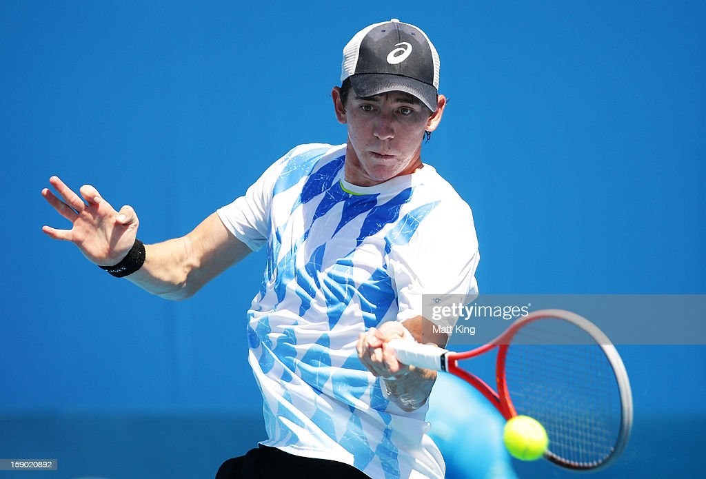 John Patrick-Smith of Australia plays a backhand in his final qualifying match against Joao Sousa of Portugal during day one of the Sydney International at Sydney Olympic Park Tennis Centre on January 6, 2013 in Sydney, Australia.