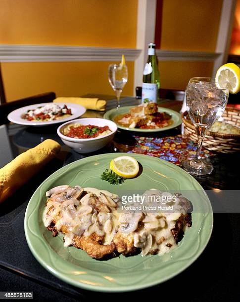 John Patriquin /Staff Photographer Wed 2/9/11 Chicken limone with amatriciana and havarti fritter served at Hug's Italian Restaurant in Falmouth for...