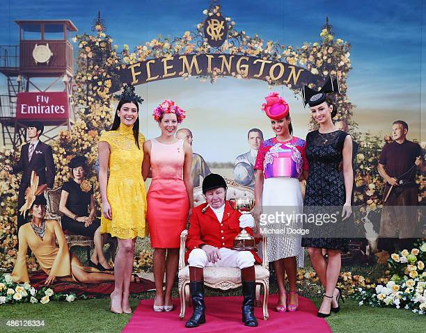 John Patterson FlemingtonÕs Clerk of the Course for more than 50 years poses with the Melbourne Cup alongside models during the Melbourne Cup...