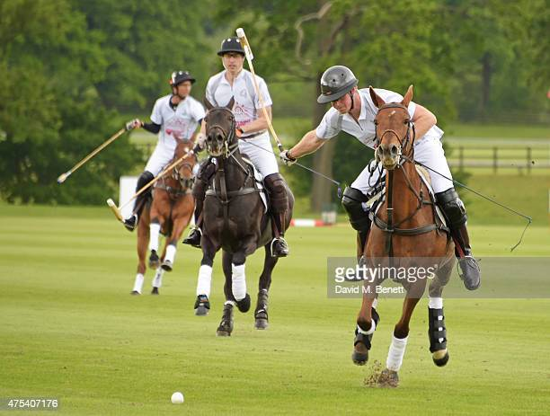 John Paul Clarkin Prince William Duke of Cambridge and Prince Harry play during day two of the Audi Polo Challenge at Coworth Park on May 31 2015 in...