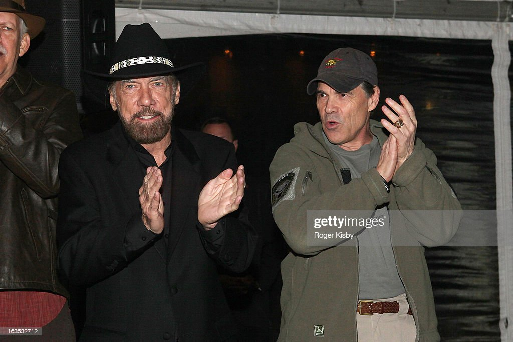 John Paul DeJoria and Texas Governor Rick Perry attend Forbes' '30 Under 30' SXSW Private Party on March 11, 2013 in Austin, Texas.
