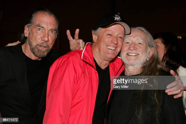 John Paul DeJoria Peter Fonda and Willie Nelson at the Nobelity Project's dinner honoring Willie Nelson with the 'Feed The Peace' award at the Four...