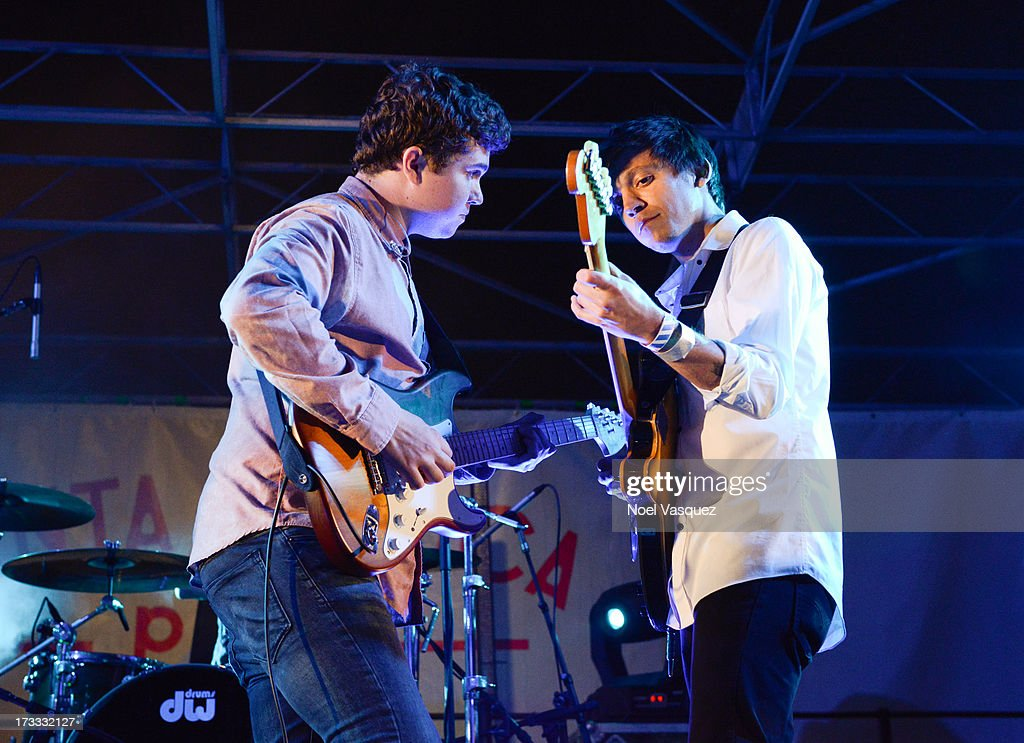John Paul Pitts (L) and Thomas Fekete of Surfer Blood perform at KCRW's Twilight Concert Series on July 11, 2013 in Santa Monica, California.