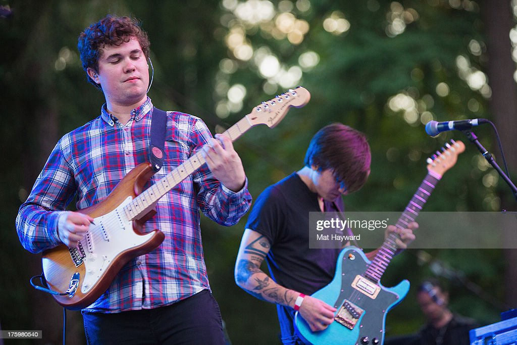 John Paul Pitts (L) and Thomas Fekete (R) of Surfer Blood perform on stage during Summer Camp hosted by 107.7 The End at Marymoor Park on August 10, 2013 in Seattle, Washington.