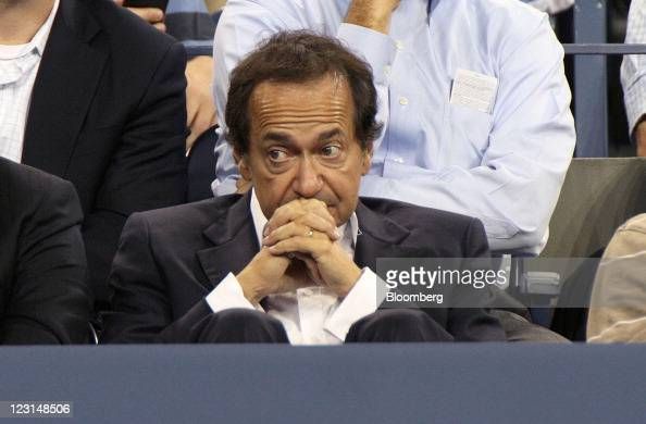John Paulson president and cofund manager of Paulson Co Inc attends a tennis match during US Open at the Billie Jean King National Tennis Center in...