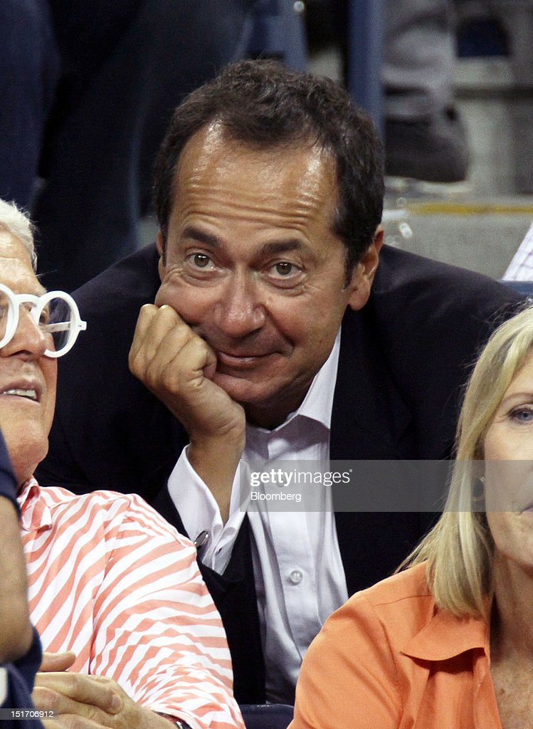 John Paulson president of Paulson Co Inc attends a tennis match during the US Open at the Billie Jean King National Tennis Center in New York US on...