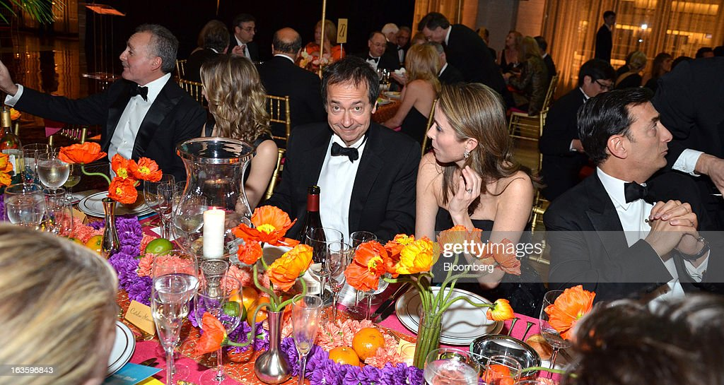 John Paulson, president of Paulson & Co. Inc., center, attends a dinner during the School of American Ballet Winter Ball at the David H. Koch Theater in New York, U.S., on Monday, March 11, 2013. The School of American Ballet Winter Ball took place at the Lincoln Center. Photographer: Amanda Gordon/Bloomberg via Getty Images