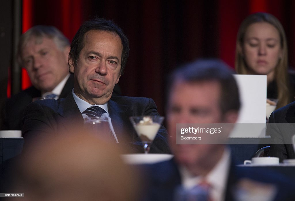 John Paulson, president of Paulson & Co. Inc., left, listens as Ben S. Bernanke, chairman of the U.S. Federal Reserve, unseen, speaks to the Economic Club of New York in New York, U.S., on Tuesday, Nov. 20, 2012. Bernanke said that an agreement on ways to reduce long-term federal budget deficits could remove an impediment to growth, while failure to avoid the so-called fiscal cliff would pose a 'substantial threat' to the recovery. Photographer: Scott Eells/Bloomberg via Getty Images