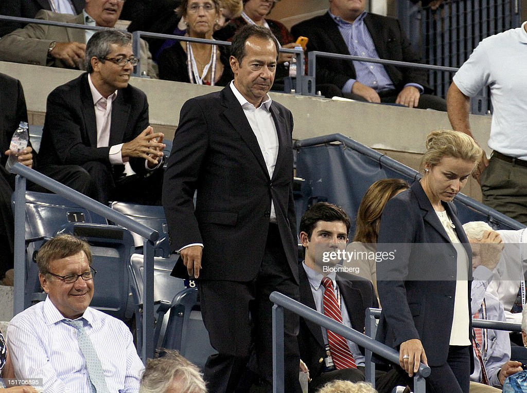 John Paulson president of Paulson Co Inc left with his wife Jenny Paulson attends a tennis match during the US Open at the Billie Jean King National...