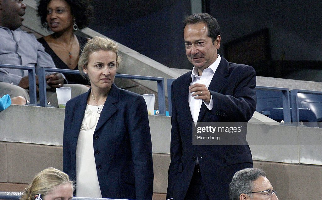 John Paulson president of Paulson Co Inc right with his wife Jenny Paulson attends a tennis match during the US Open at the Billie Jean King National...