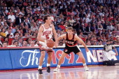 John Paxson of Chicago Bulls looks drive against Danny Ainge of the Portland Trail Blazers during Game Two of the 1992 NBA Finals on June 5 1992 at...