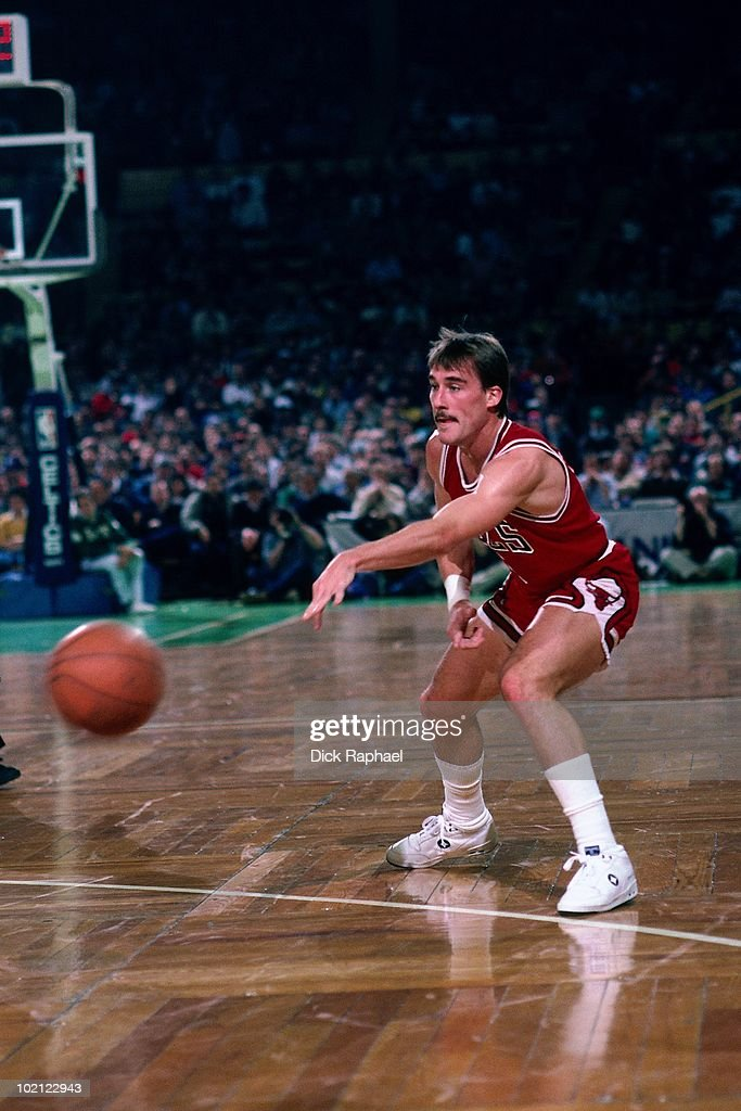 John Paxson #5 of the Chicago Bulls passes against the Boston Celtics during a game played in 1987 at the Boston Garden in Boston, Massachusetts.