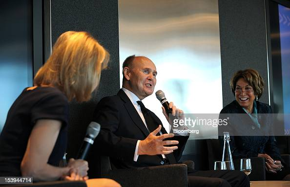John Peace chairman of Burberry Group Plc center speaks while Laura D'Andrea Tyson economics professor at the Haas School of Business at the...