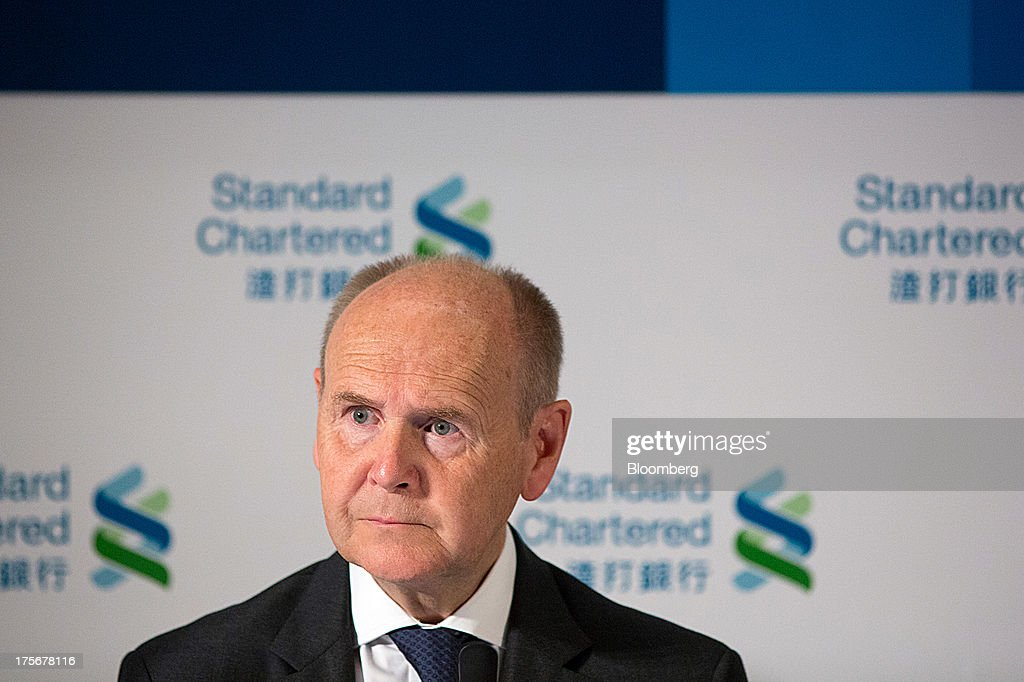 John Peace, chairman of Standard Chartered Plc, pauses during a news conference in Hong Kong, China, on Tuesday, Aug. 6, 2013. Standard Chartered, the U.K. bank that makes about three quarters of its earnings from Asia, posted a 24 percent drop in first-half profit after writing down the value of its Korean business by $1 billion. Photographer: Lam Yik Fei/Bloomberg via Getty Images