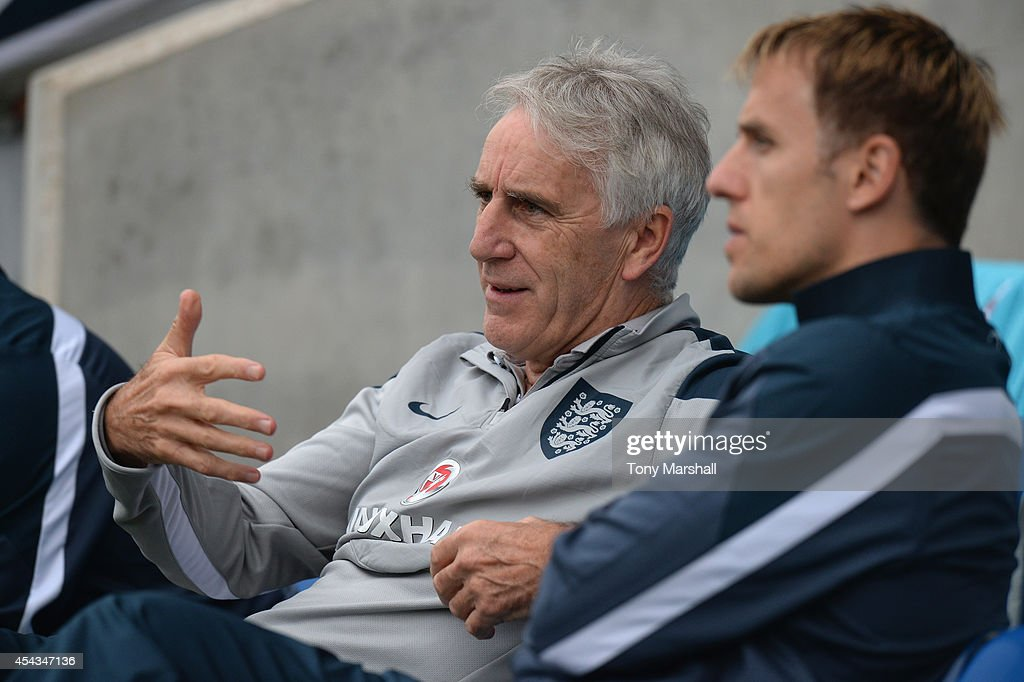 John Peacock, Manager of England talks with <a gi-track='captionPersonalityLinkClicked' href=/galleries/search?phrase=Phil+Neville&family=editorial&specificpeople=201898 ng-click='$event.stopPropagation()'>Phil Neville</a> during the Under 17 International match between England U17 and Portugal U17 at Proact Stadium on August 29, 2014 in Chesterfield, England.