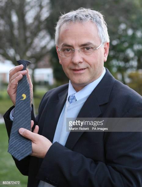 John Peckham headmaster of Bramhall High School Stockport holds a clip on tie