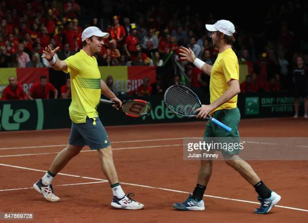 John Peers and Jordan Thompson of Australia celebrate at match point in the doubles match against Ruben Bemelmans and Arthur De Greef of Belgium...