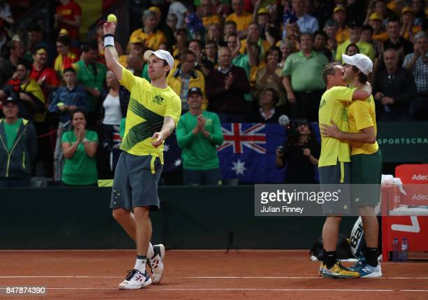 John Peers and Jordan Thompson of Australia celebrate defeating Ruben Bemelmans and Arthur De Greef of Belgium in the doubles during day two of the...