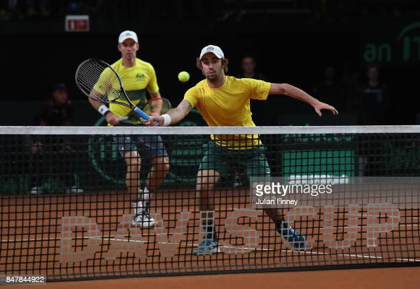John Peers and Jordan Thompson of Australia in action in the doubles match against Ruben Bemelmans and Arthur De Greef of Belgium during day two of...