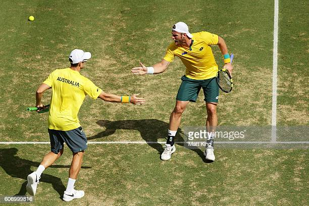 John Peers and Sam Groth of Australia celebrate winning the first set in the doubles match against Andrej Martin and Igor Zelenay of Slovakia during...