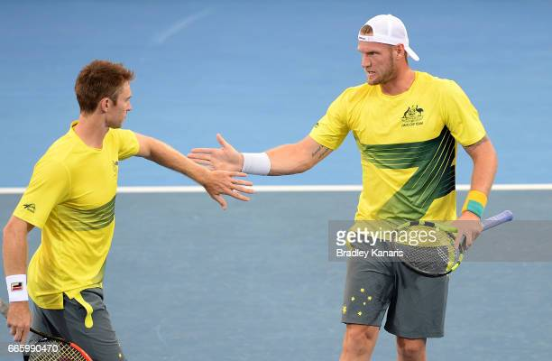 John Peers and Sam Groth of Australia celebrates winning a point in their doubles match against Steve Johnson and Jack Sock of the USA during the...