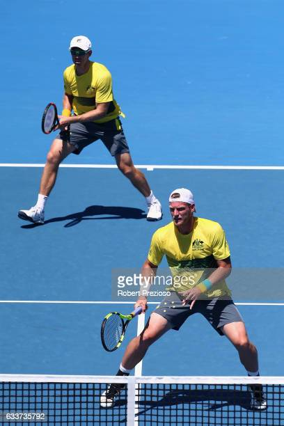 John Peers and Sam Groth of Australia compete in their doubles match against Jiri Vesely and Jan Satral of Czech Republic during the first round...