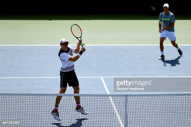John Peers of Australia and Henri Kontinen of Finland return a shot against William Blumberg and Spencer Papa of the United States during their first...