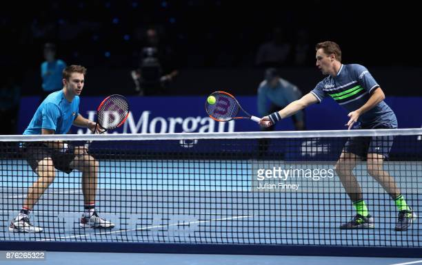 John Peers of Australia and Henri Kontinen of Finland return the ball during the doubles final against Marcelo Melo of Brazil and Lukasz Kubot of...