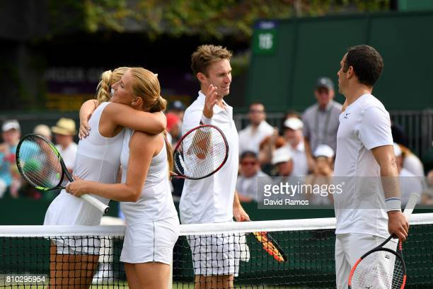 John Peers of Australia and Sabine Lisicki of Germany shake hands with Scott Lipsky of the United States and Alla Kudryavtseva of Russia after the...