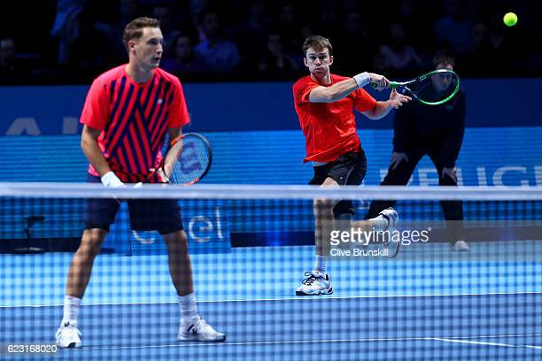 John Peers of Australia hits a forehand next to his partner Henri Kontinen of Finland during the mens doubles match against Feliciano Lopez of Spain...