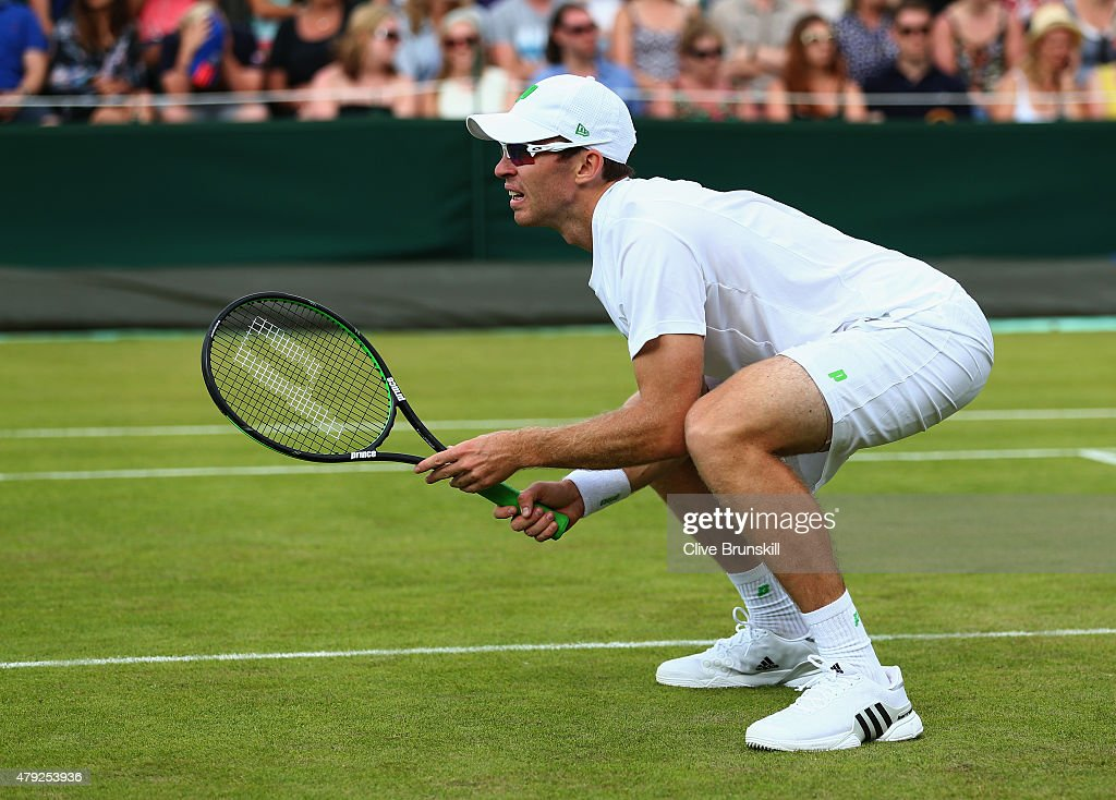 John Peers of Australia in action in his Gentlesmens Doubles First Round match with Jamie Murray of Great Britain against Luke Bambridge of Great...