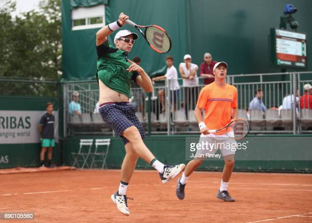 John Peers of Australia partner of Henri Kontinen of Finland returns the ball during the mens doubles first round match against David Marrero of...