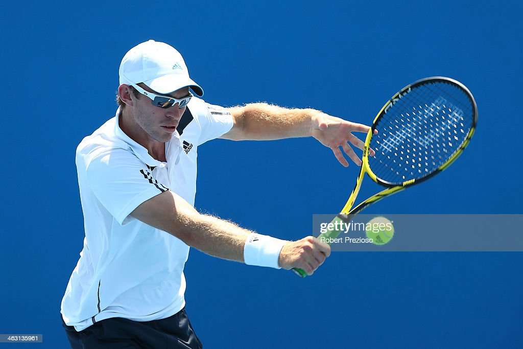 John Peers of Australia plays a backhand in her first round mixed doubles match with Ashleigh Barty of Australia against Olivia Rogowska of Australia...