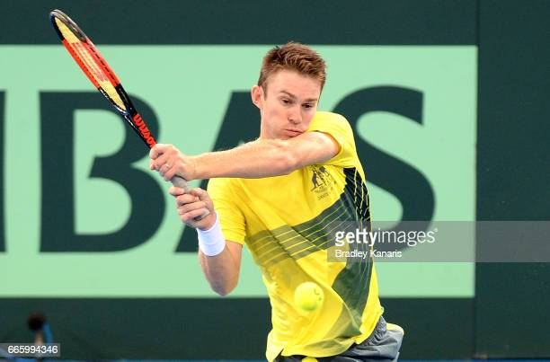 John Peers of Australia plays a backhand in his doubles match against Steve Johnson and Jack Sock of the USA during the Davis Cup World Group...