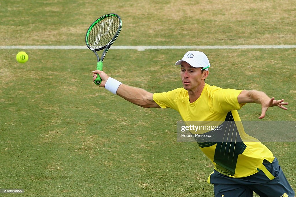 John Peers of Australia plays a forehand in Men's doubles match against Mike Bryan and Bob Bryan of the United States during the Davis Cup tie...