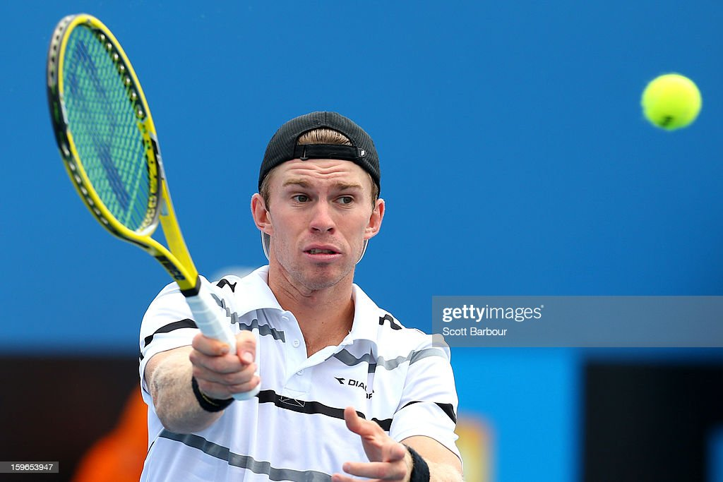 John Peers of Australia plays a forehand in their first round doubles match with John-Patrick Smith of Australia against Mikhail Youzhny of Russia and Sergiy Stakhovsky of the Ukraine during day five of the 2013 Australian Open at Melbourne Park on January 18, 2013 in Melbourne, Australia.