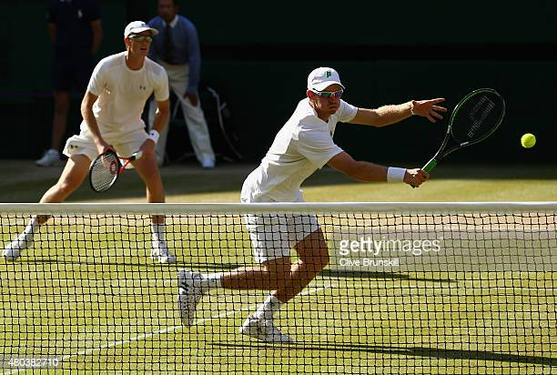 John Peers of Australia plays a volley playing with Jamie Murray of Great Britain in the Final Of The Gentlemen's Doubles against Horia Tecau of...