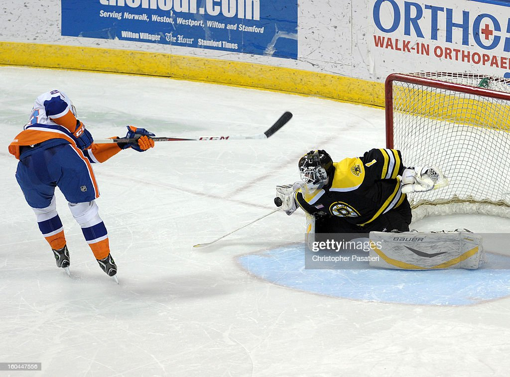John Persson #23 of the Bridgeport Sound Tigers has his shot on goal stopped by Niklas Svedberg #1 of the Providence Bruins during the shoot out of an American Hockey League on January 31, 2013 at the Webster Bank Arena at Harbor Yard in Bridgeport, Connecticut.