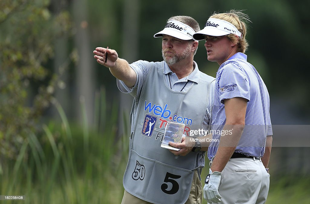 John Peterson (R) gets the line from his caddie on the eighth hole during the third round of the Web.com Tour Championship held on the Dye's Valley Course at TPC Sawgrass on September 28, 2013 in Ponte Vedra Beach, Florida.