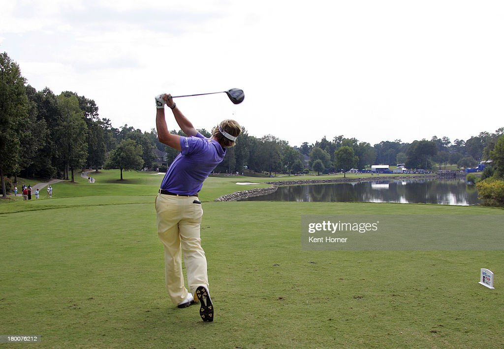 John Peterson hits the ball off of the 18th tee during the final round of the Chiquita Classic in the Web.com tour finals at River Run Country Club on September 8, 2013 in Davidson, North Carolina.