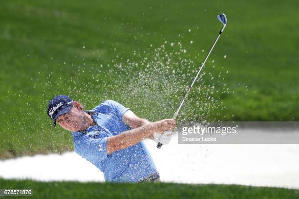 John Peterson plays a shot from a bunker on the sixth hole during round one of the Wells Fargo Championship at Eagle Point Golf Club on May 4 2017 in...