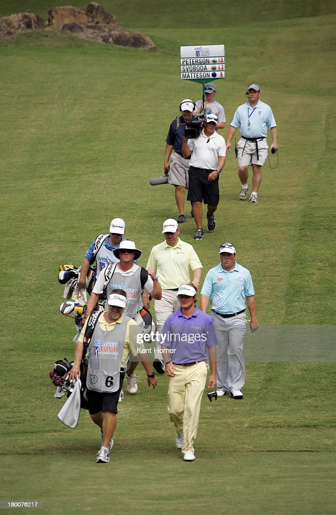 John Peterson walks ahead of playing partners Andrew Svoboda and Troy Matteson down the 17th fairway during the final round of the Chiquita Classic...